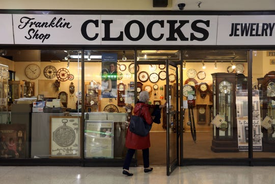 A customer walks into the Franklin Clock Shop at the White Plains Mall on Monday.