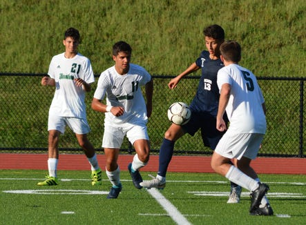 Colby Cho (13) splits a pair of defenders and moves the ball forward in transition during a 3-0 win over Pleasantville on Sept. 4, 2018 in the opening round of the Mount Pleasant Cup.