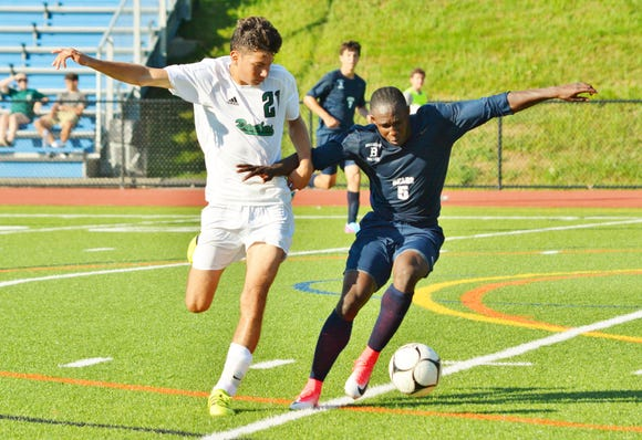 Briarcliff forward Jason Oppong (5) tries to control the ball along the sideline during a 4-0 win over Pleasantville on Sept. 4, 2018.