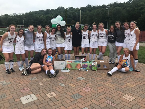 Albertus Magnus players at Yorktown High with their donations for the homeless dogs and cats of Westchester's SPCA