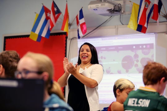 "Jenice Mateo-Toledo, Director of Diversity and Inclusion at Farragut Middle School in Hastings-on-Hudson, applauds after student presented a personal biography to the class work Sept. 7, 2018. Mateo-Toledo teaches a sixth-grade class called ""Courageous Conversations, which deals with issues of race, racism and current events."