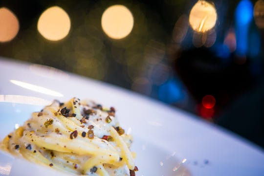 Chef Antimo DiMeo cooks up a Cacio e Pepe dish, a classic Roman dish of cheese and pepper at Bardea Italian restaurant on N. Market Street in downtown Wilmington.
