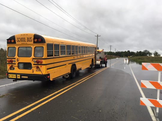 A Colonial School District bus carrying 45 students caught caught in flood water Monday. A district tow truck pulled it free.
