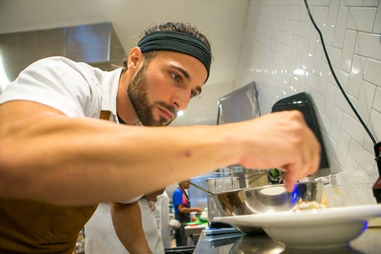 Chef Antimo DiMeo plates a Cacio e Pepe dish, a classic Roman dish of cheese and pepper as Bardea Italian restaurant on N. Market Street in downtown Wilmington gets ready to open it's doors.