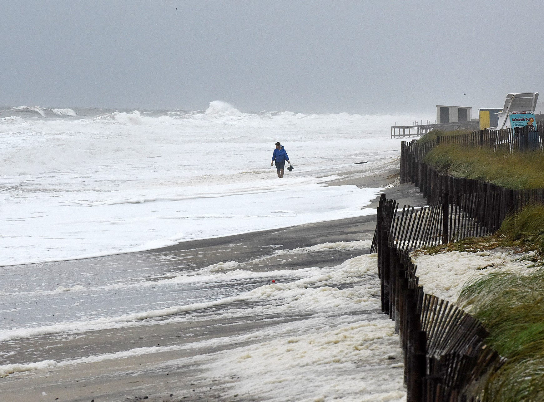 Hurricane Florence is causing stormy conditions and red flag warnings at Rehoboth Beach Monday morning.  Rehoboth city crews removed trash cans and beach mobi-mats from the dune crossings as the surf reaches the boardwalk at high tide.