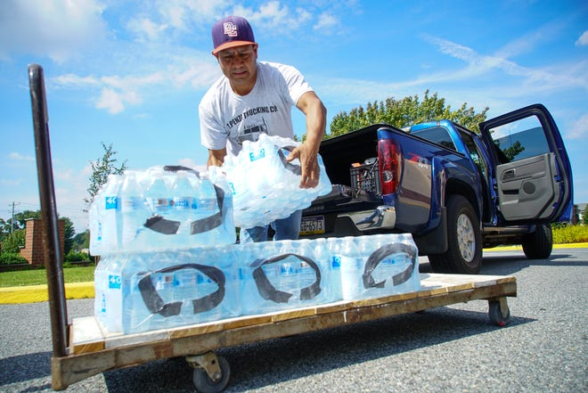 Officials recommend stocking up on bottled water before a hurricane arrives.
