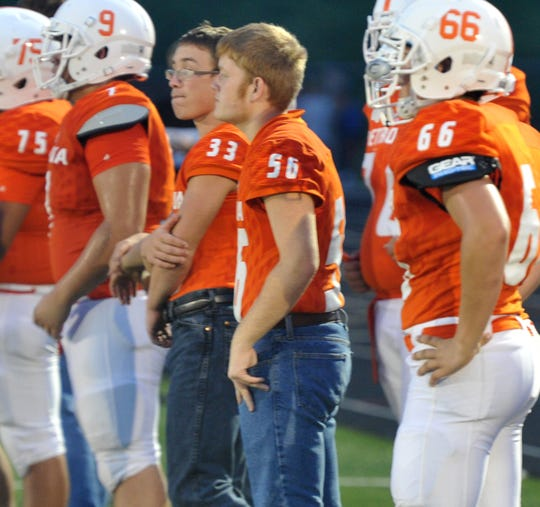 Petrolia's Wade Colley stands on the sideline during the Pirates' home game against Olney.