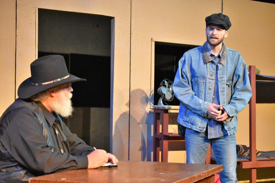 "Jan Smith and Albert Brown rehearsing a scene from ""Of Mice and Men"" opening at the Zanesville Community Theatre."