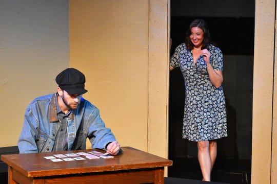 "Albert Brown and Monica Van Nort in a scene from ""Of Mice and Men"" opening at the Zanesville Community Theatre."