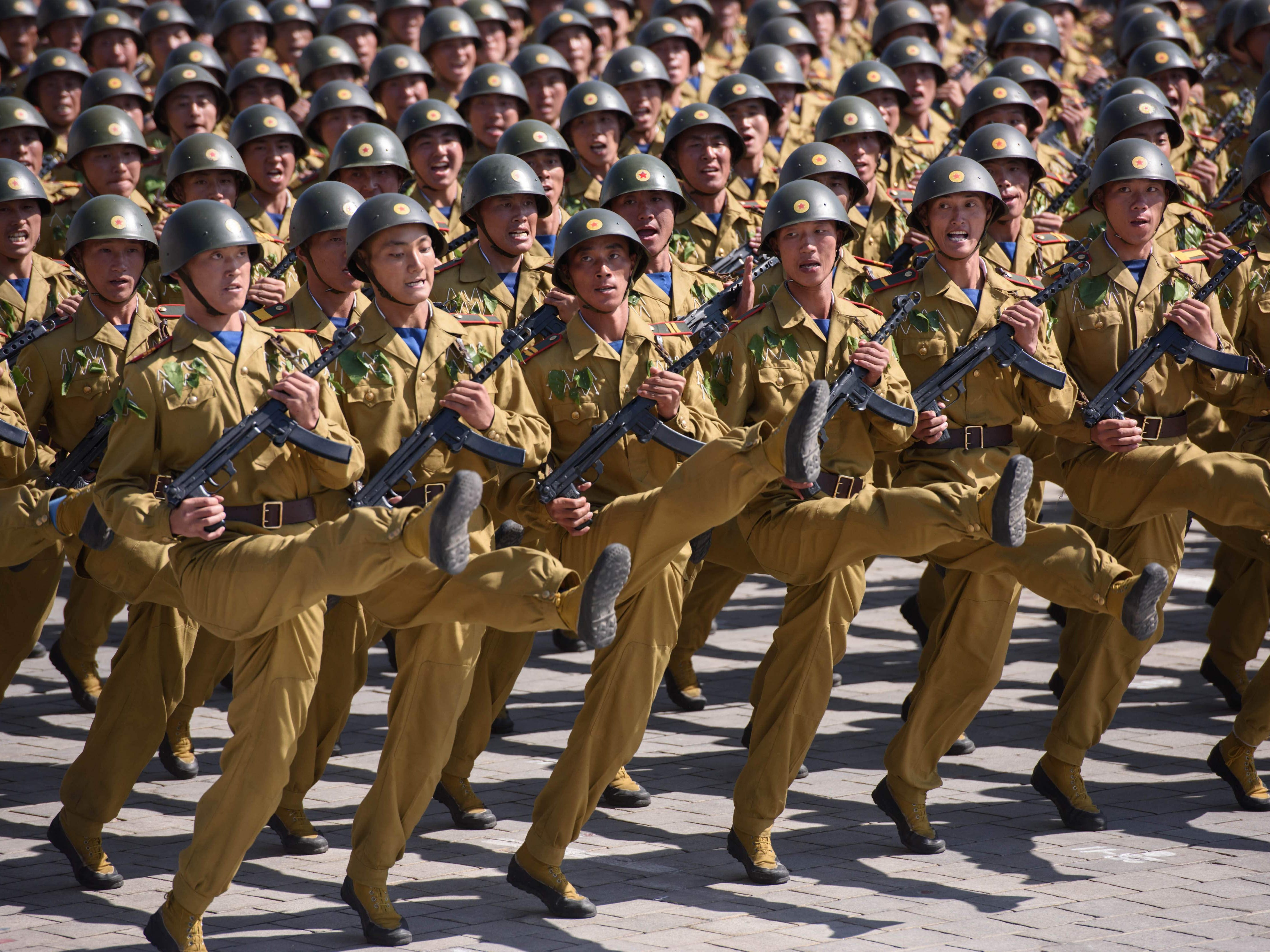 Korean People's Army soldiers march during a mass rally on Kim Il Sung square in Pyongyang on Sept. 9, 2018. North Korea held a military parade to mark its 70th birthday, but refrained from showing off the intercontinental ballistic missiles that have seen it hit with multiple international sanctions.