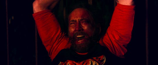 "Nicolas Cage gets physical action scenes as well as scenes of harrowing emotion in ""Mandy."""