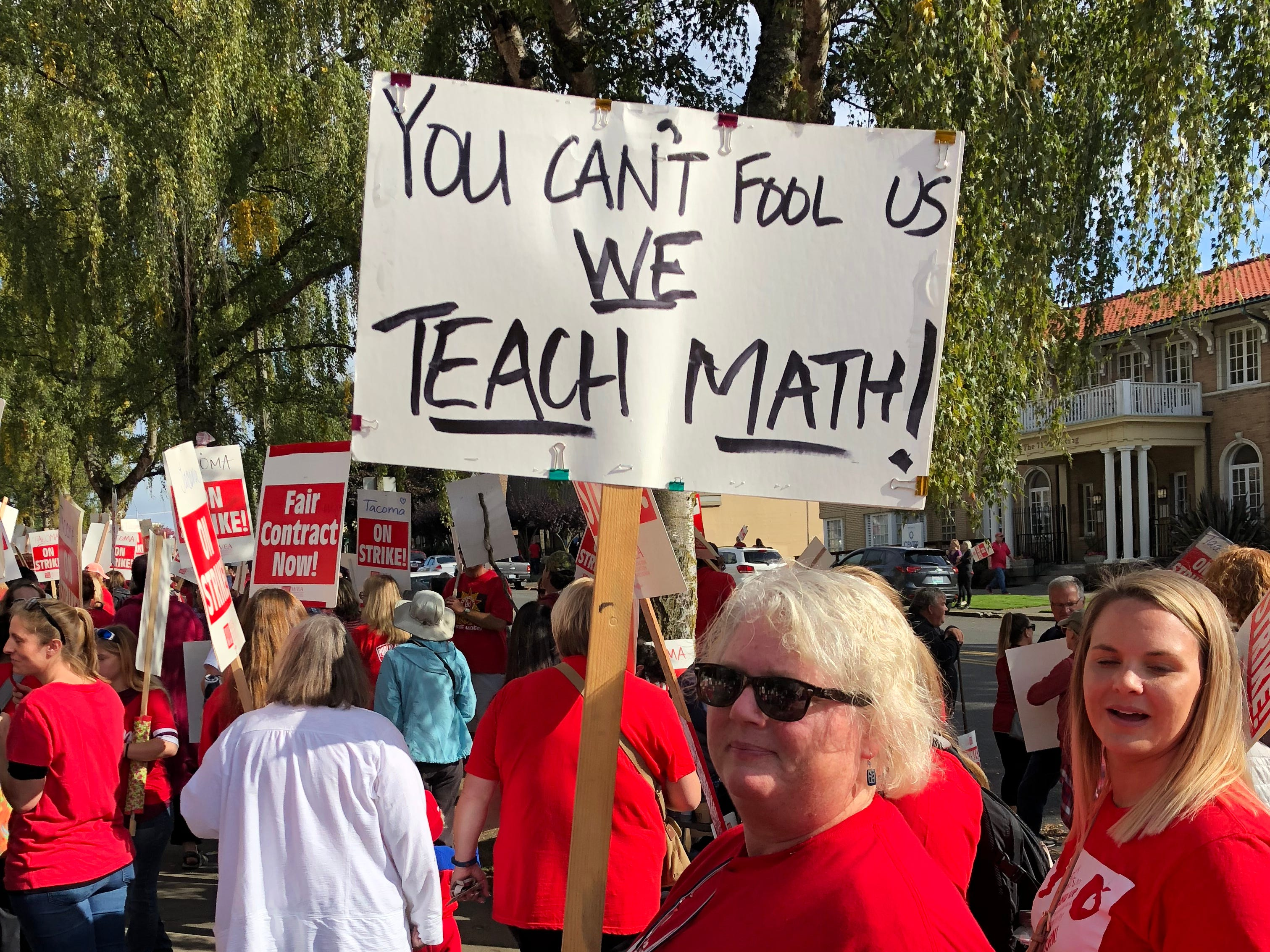 More than 2200 teachers -- plus hundreds of parents and students who showed up to voice their support -- from the Tacoma School District in Tacoma, Wash., Sept. 10, 2018, walked the picket line Monday on the third day of the Tacoma teachers' strike, many of them carrying hand-made signs.
