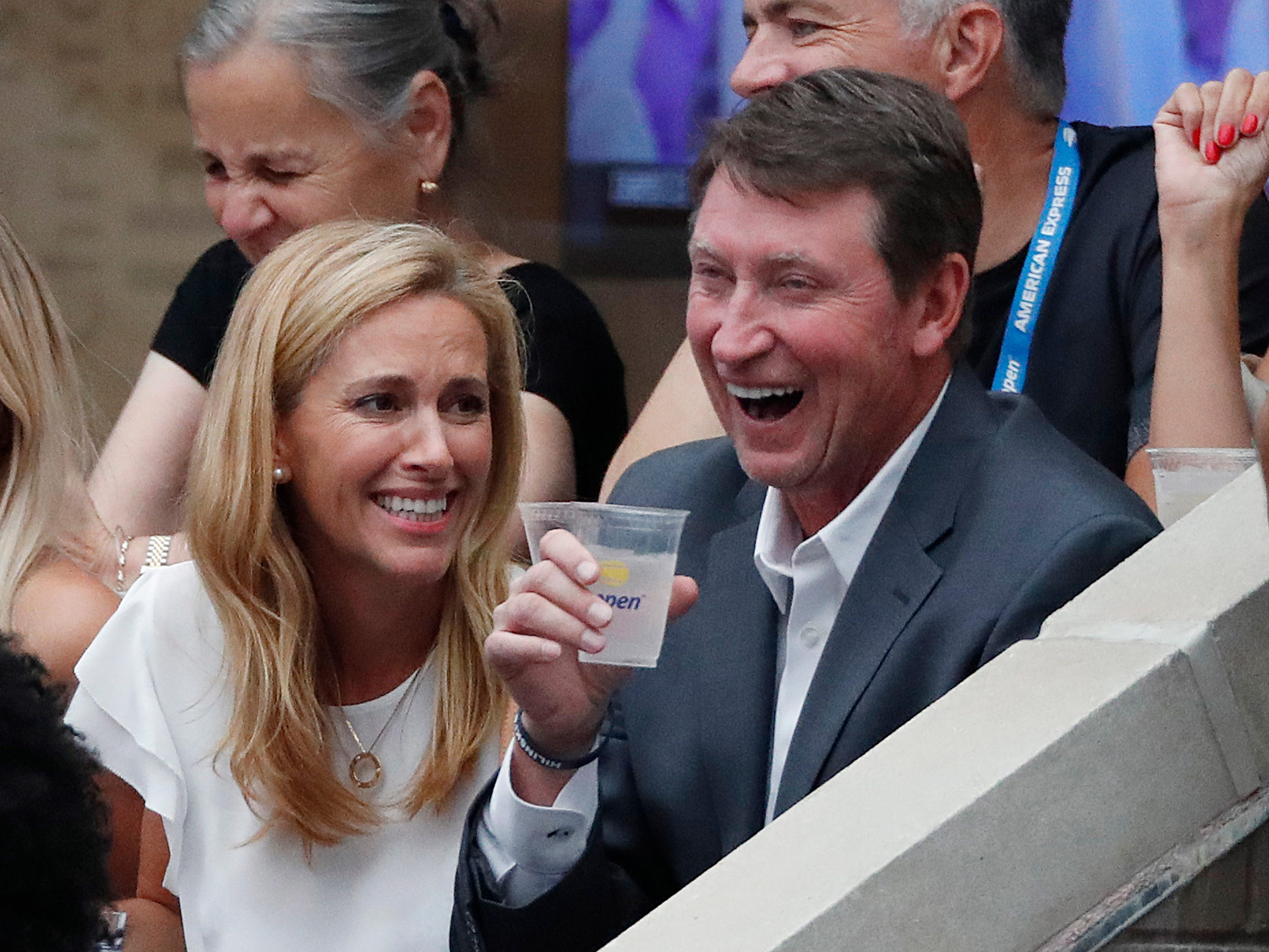 Hockey Hall of Famer Wayne Gretzky, right,  watches the women's final match between Serena Williams and Naomi Osaka.