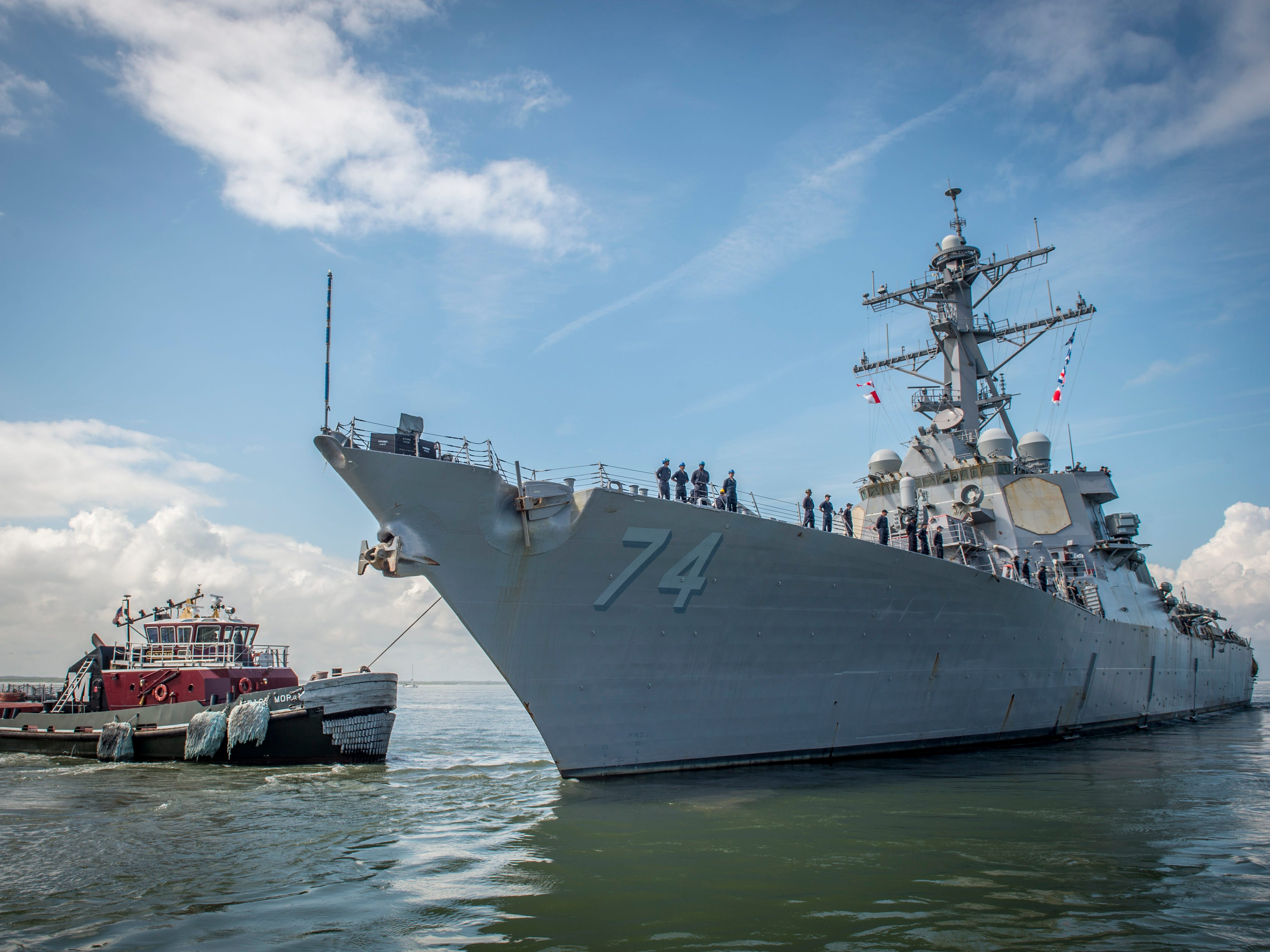 A handout photo made available by the Navy Office of Information shows The guided-missile destroyer USS McFaul (DDG 74) departing in Norfolk, Va., Sept. 10, 2018. There are nearly 30 ships preparing to get underway from Naval Station Norfolk and Joint Expeditionary Base Little Creek as Hurricane Florence is forecasted to bring high winds and rain to the Mid-Atlantic coast. Ships will be directed to areas of the Atlantic where they can best avoid the storm.