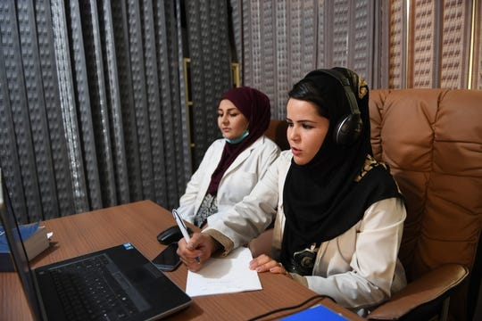 Midwives take calls at the Midwifery Helpline Center in Kabul, Afghanistan.