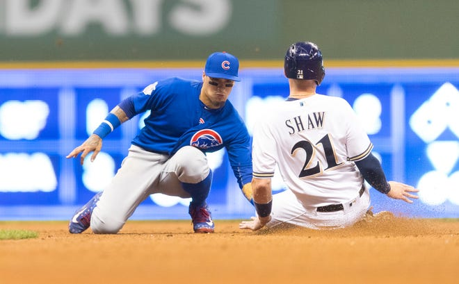Javier Baez tags out Travis Shaw during a June game in Milwaukee.