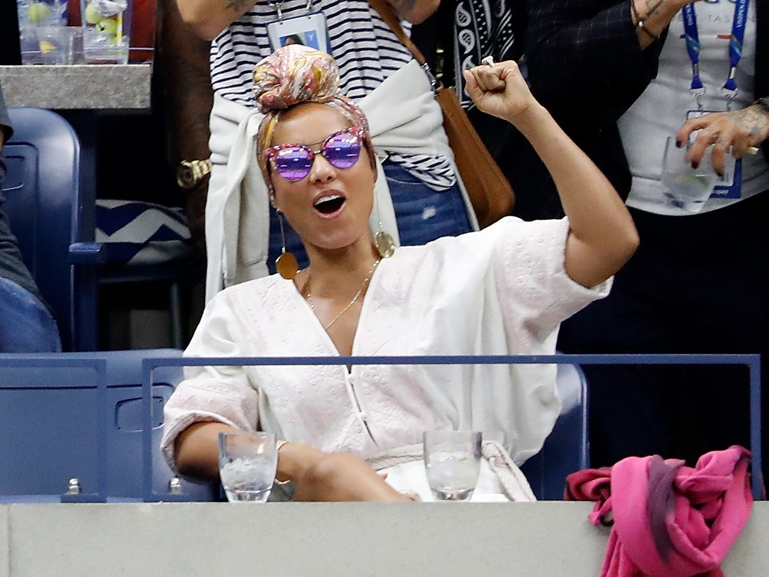 Singer/songwriter Alicia Keys watch the women's final between Serena Williams and Naomi Osaka.
