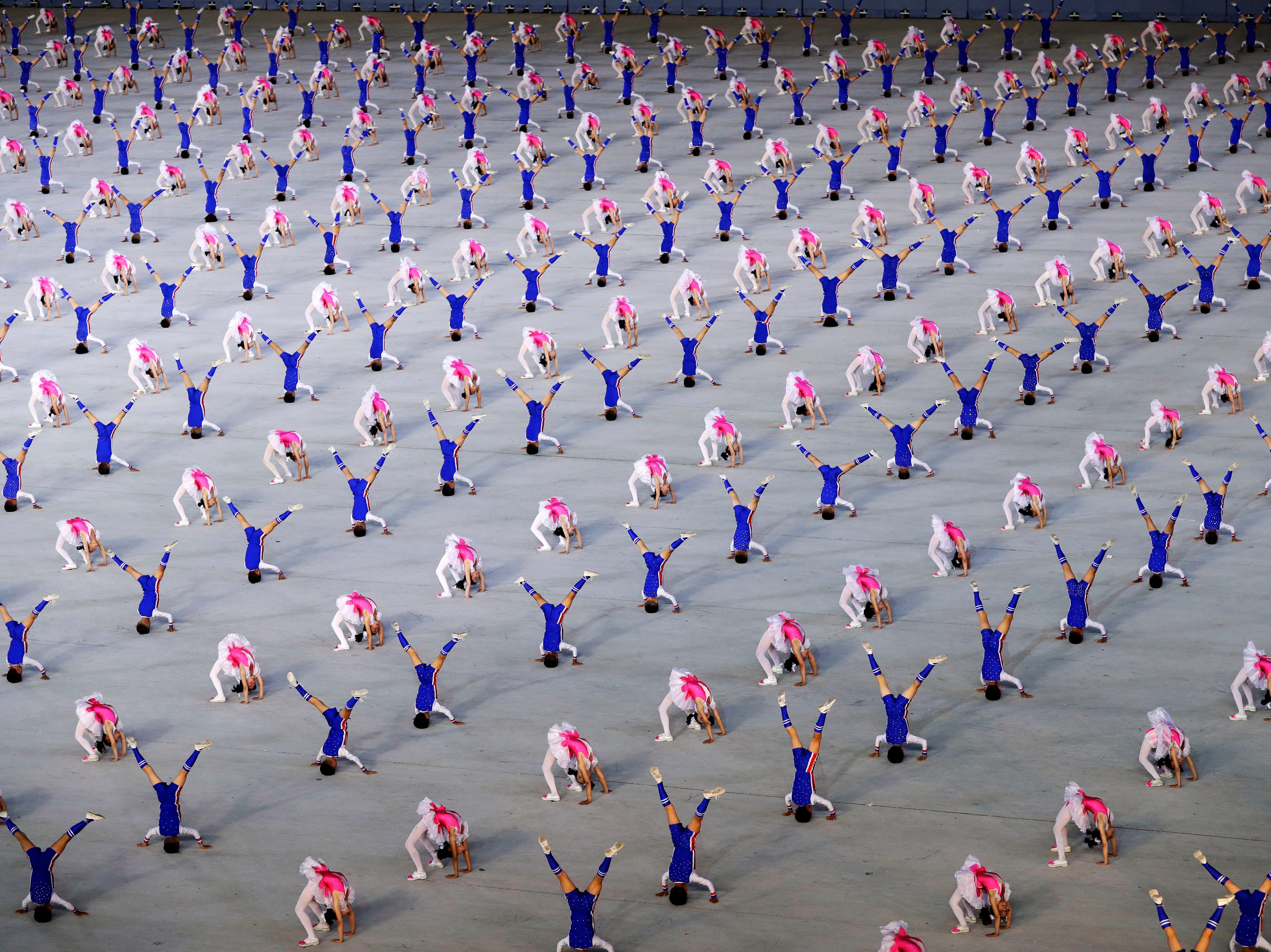 "Participants perform during the ""Glorious Country"" mass games held in conjunction with the 70th anniversary of North Korea's founding day in Pyongyang, North Korea, Sunday, Sept. 9, 2018."