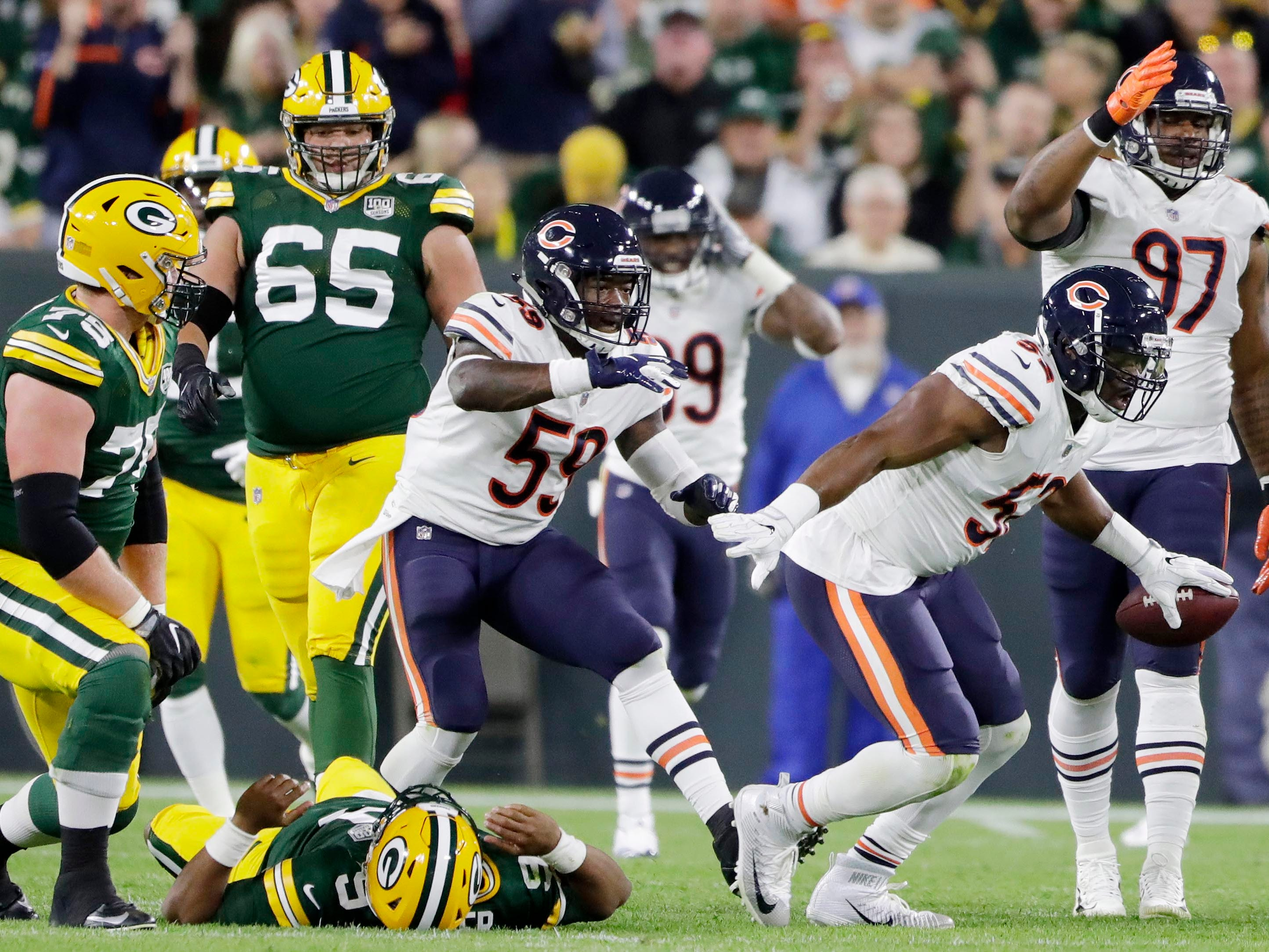 Sep 9, 2018; Green Bay, WI, USA;  Chicago Bears linebacker Khalil Mack (52) reacts after recovering a fumble by Green Bay Packers quarterback DeShone Kizer (9) in the second quarter at Lambeau Field.  Mandatory Credit: Adam Wesley/Green Bay Press Gazette via USA TODAY NETWORK