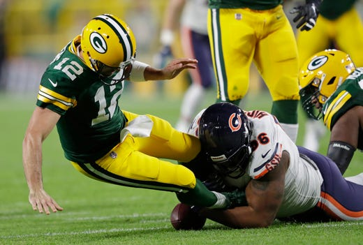 Sep 9, 2018; Green Bay, WI, USA;  Green Bay Packers quarterback Aaron Rodgers (12) is sacked by Chicago Bears defensive end Akiem Hicks (96) in the first quarter at Lambeau Field.  Mandatory Credit: Dan Powers/Appleton Post-Crescent via USA TODAY NETWORK - Packers QB Carted Off In Clash With Bears