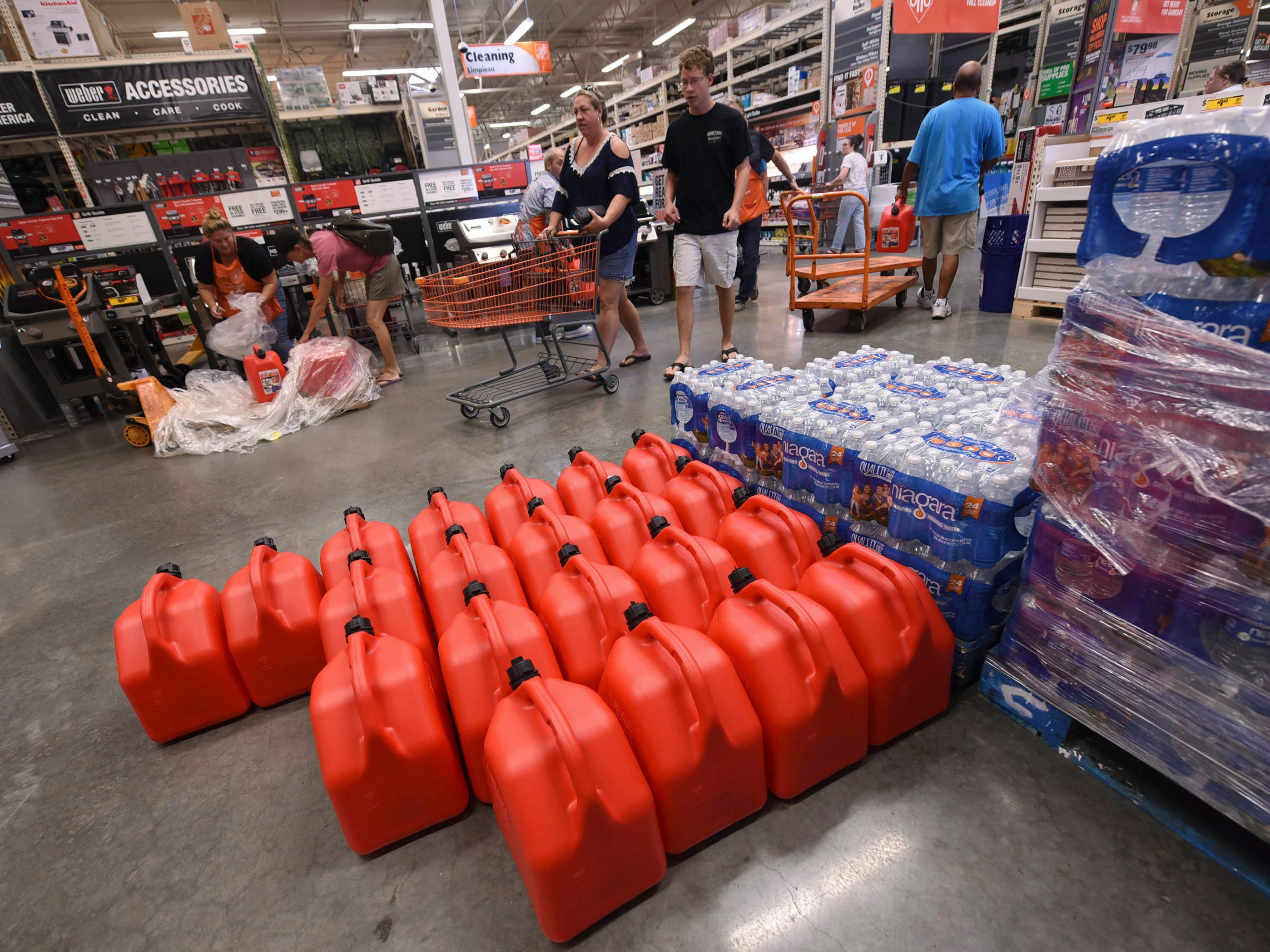 People buy supplies at The Home Depot on Monday, Sept. 10, 2018, in Wilmington, N.C.
