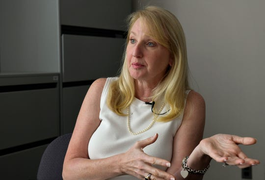 Karen Siska-Creel, the director of nursing for the Anne Arundel County, Maryland, school health services, has pushed to expand access to the opioid overdose reversal drug naloxone.