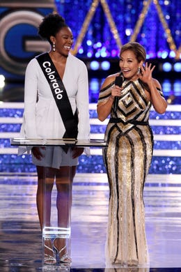 Miss America 2019 show host Carrie Ann Inaba works up the crowd in front of Miss Colorado Ellery Jones during the interview portion of the competition from Boardwalk Hall.