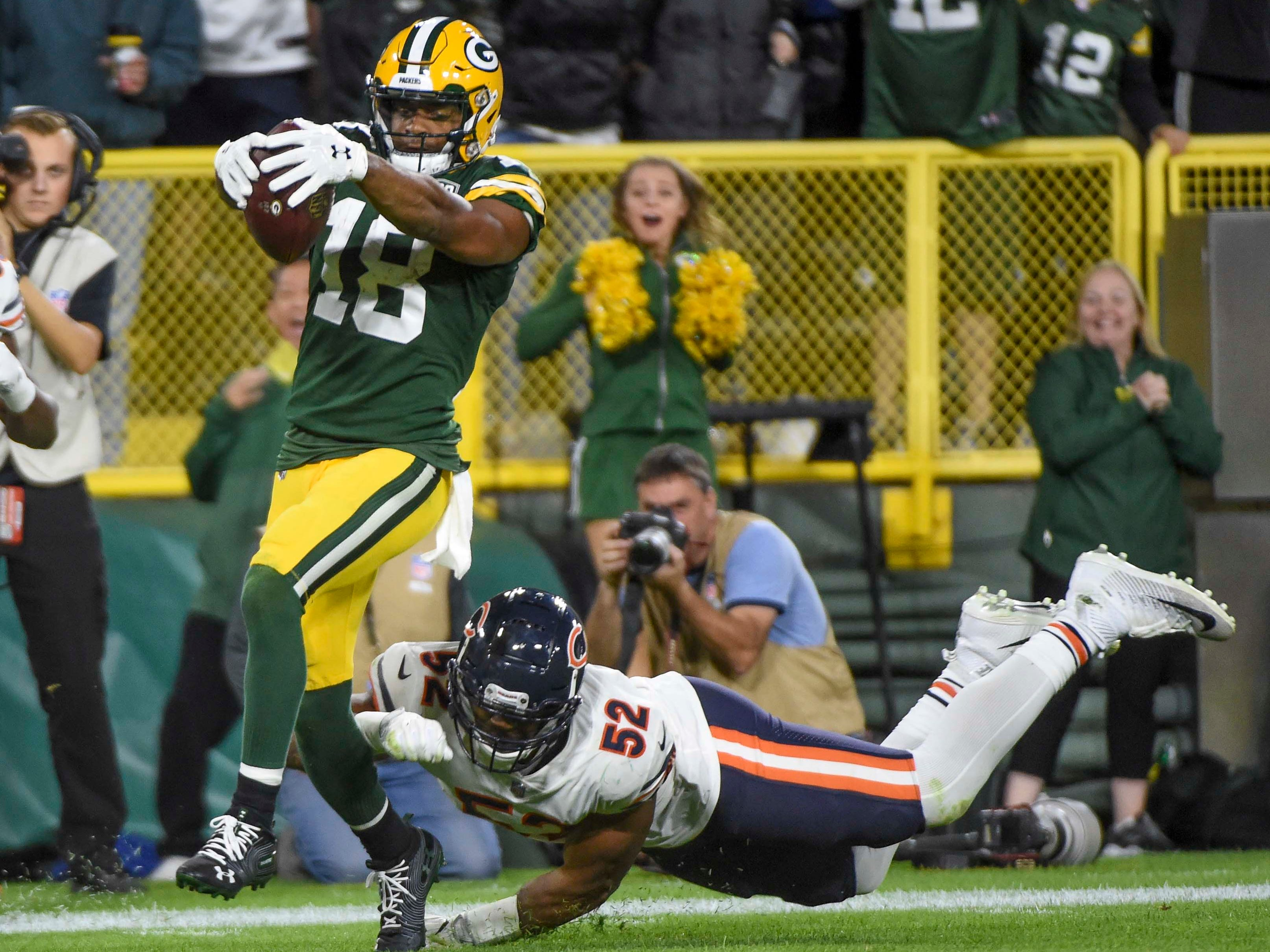 Green Bay Packers wide receiver Randall Cobb gets past Chicago Bears linebacker Khalil Mack to score the winning touchdown in the fourth quarter at Lambeau Field.