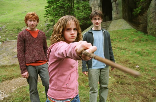 "Rupert Grint, Emma Watson and Daniel Radcliffe are ready for action in i the motion picture ""Harry Potter and the Prisoner of Azkaban."""