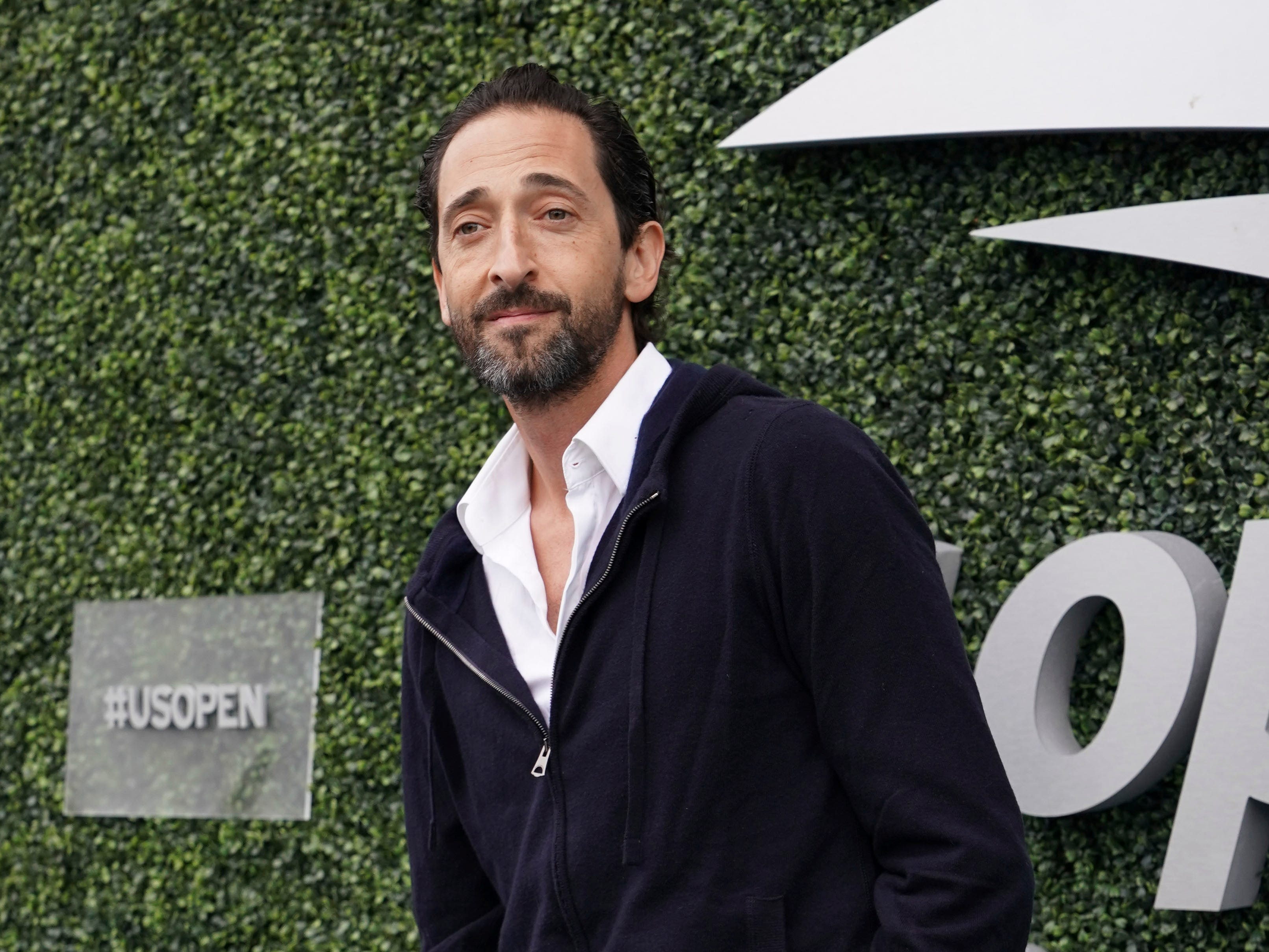 Actor Adrien Brody attends the women's final between Serena Williams and Naomi Osaka.