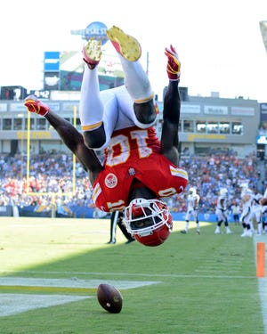 Kansas City Chiefs wide receiver Tyreek Hill (10) flips in celebration after a fourth quarter touchdown  against the Los Angeles Chargers at StubHub Center.