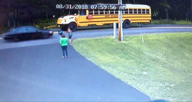 A speeding car nearly strikes a young boy in home surveillance footage filmed in Gilford, New Hampshire.
