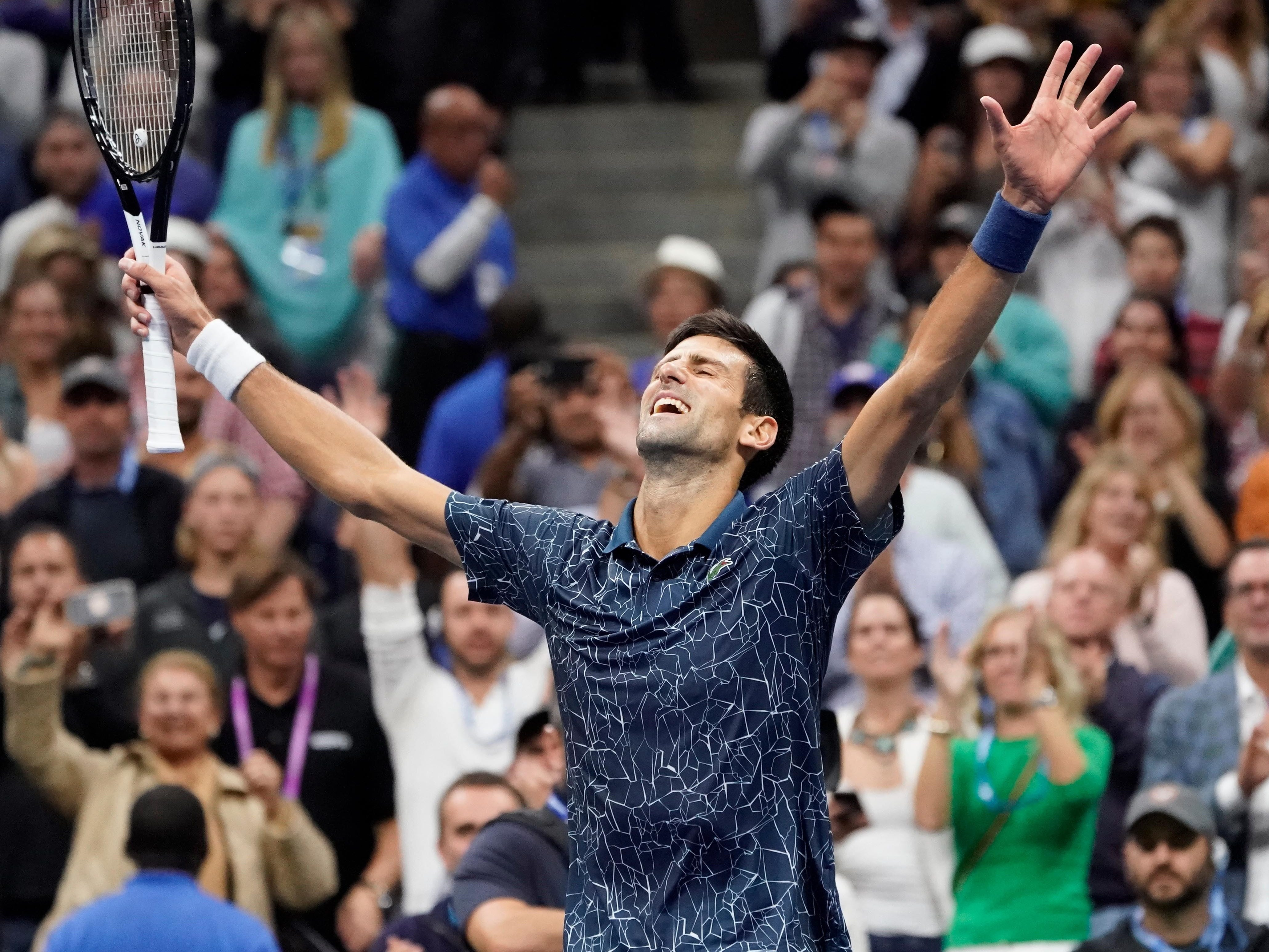 Novak Djokovic celebrates after clinching match point against Juan Martin del Potro.