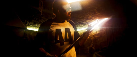 "Red (Nicolas Cage) prepares for war by forging a destructive ax in the fantasy thriller ""Mandy."""