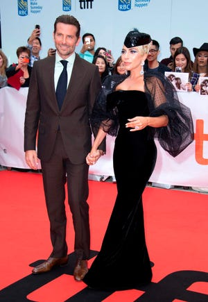 "Bradley Cooper and Lady Gaga looked smashing as they debuted ""A Star Is Born"" at Toronto International Film Festival on Sunday."