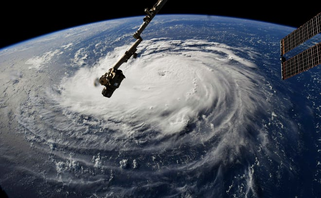 This photo provided by NASA shows Hurricane Florence from the International Space Station on Monday, Sept. 10, 2018, as it threatens the U.S. East Coast. Forecasters said Florence could become an extremely dangerous major hurricane sometime Monday and remain that way for days.