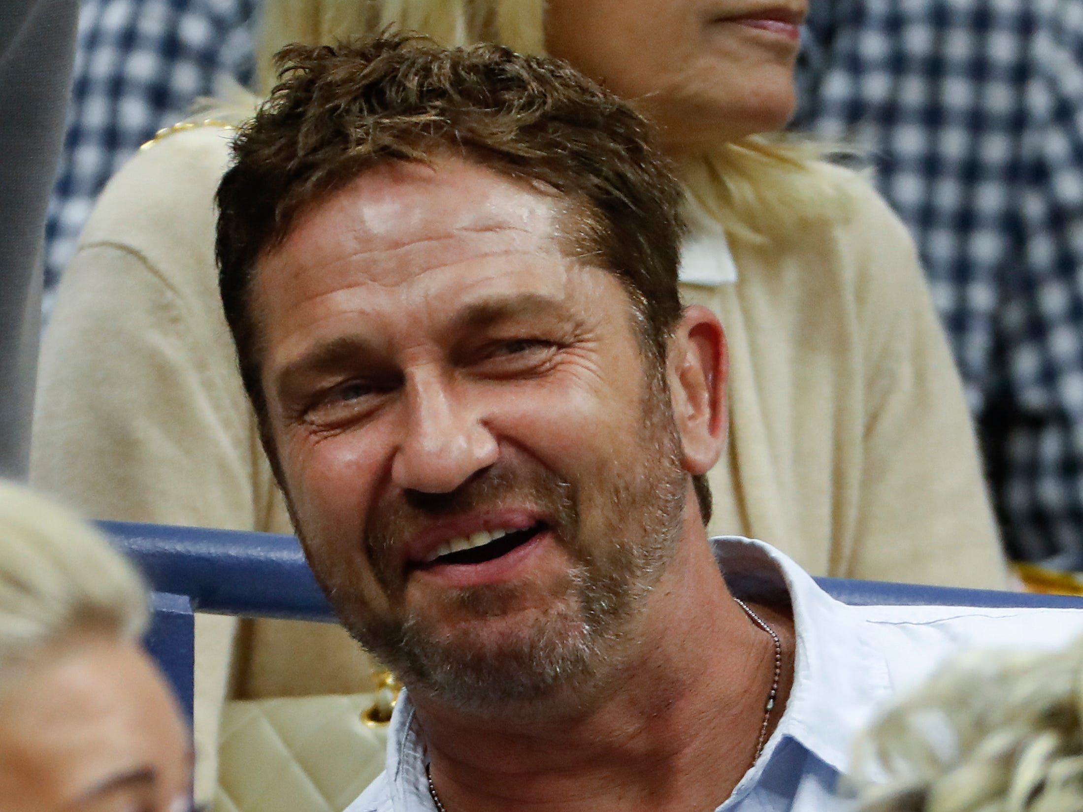 Actor Gerard Butler watches the men's final between Novak Djokovic and Juan Martin del Potro.