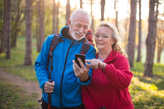 Active Seniors Looking At Smartphone