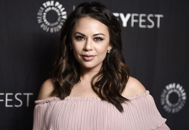 Janel Parrish, photographed in March 2017, and longtime boyfriend Chris Long have gotten married.