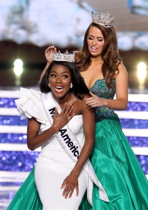 Miss America 2019 Nia Imani Franklin from New York is crowned by Miss America 2018 Cara Mund at Boardwalk Hall.