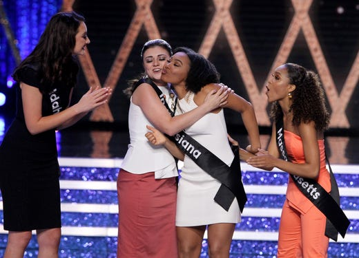 Miss Louisiana Holli' Conway shares a kiss with another contestant as she is chosen to be in the top 10 during the Miss America 2019 show from Boardwalk Hall.