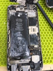 The inside of an iPhone that had gotten wet and then not been properly dried out.