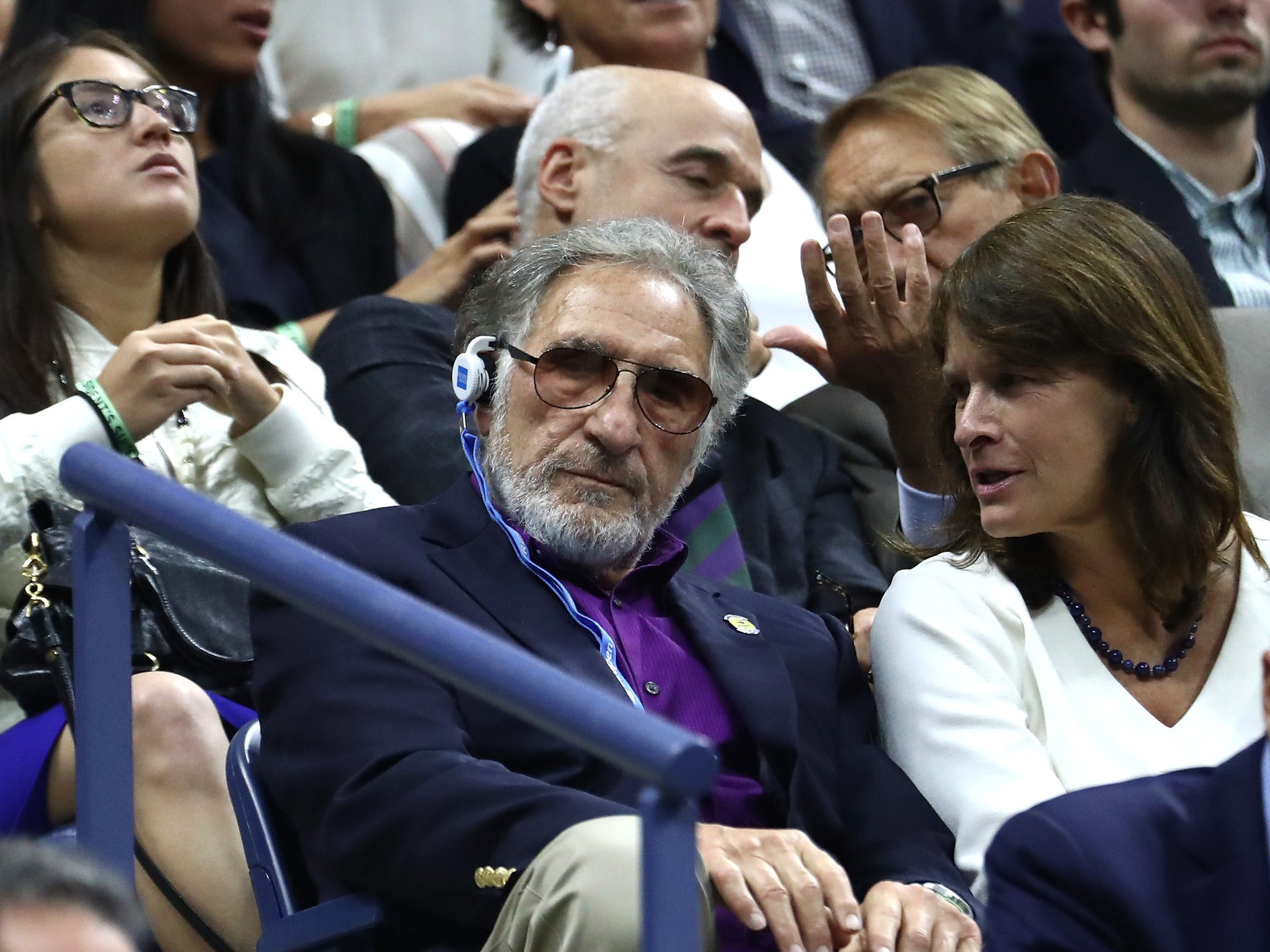 Actor Judd Hirsch, left, watches the men's final between Novak Djokovic and Juan Martin del Potro.