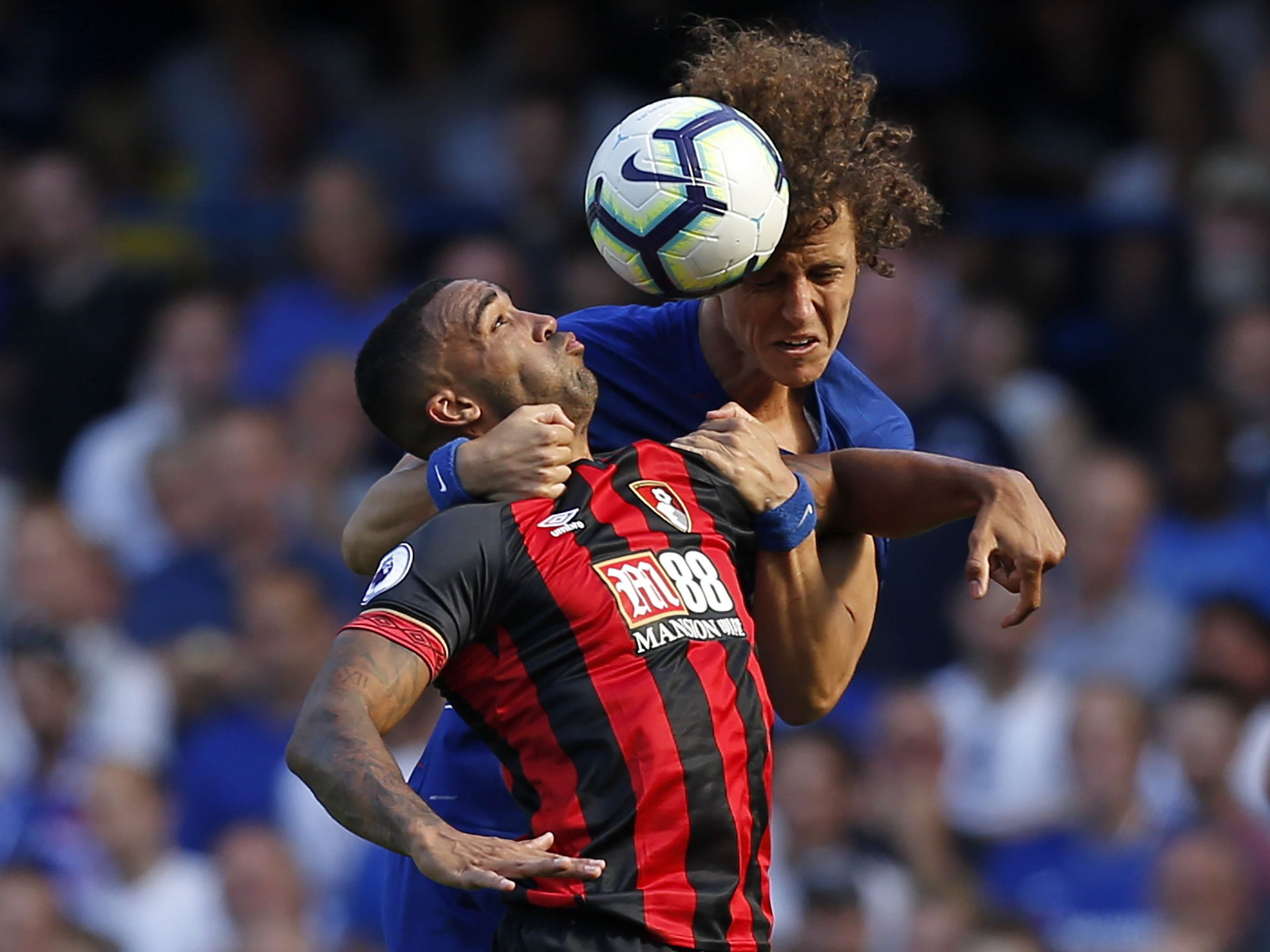 Bournemouth's Callum Wilson (left) vies with Chelsea's David Luiz during the Premier League match at Stamford Bridge in London. Chelsea won the match, 2-0.