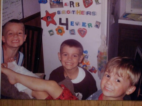 Razy Sellars, right, seen here with his brothers, Riley, left, and Rory, died by suicide in May.  This photo was taken about six years ago.
