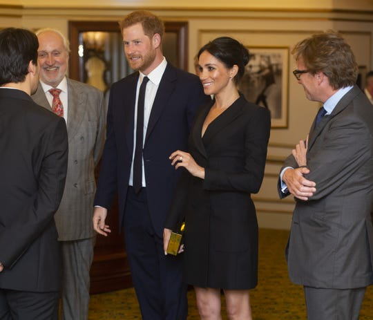 """Prince Harry and Duchess Meghan of Sussex speak at a gala performance of """"Hamilton"""" in support of Sentebale in London on Aug. 29, 2018 in London."""