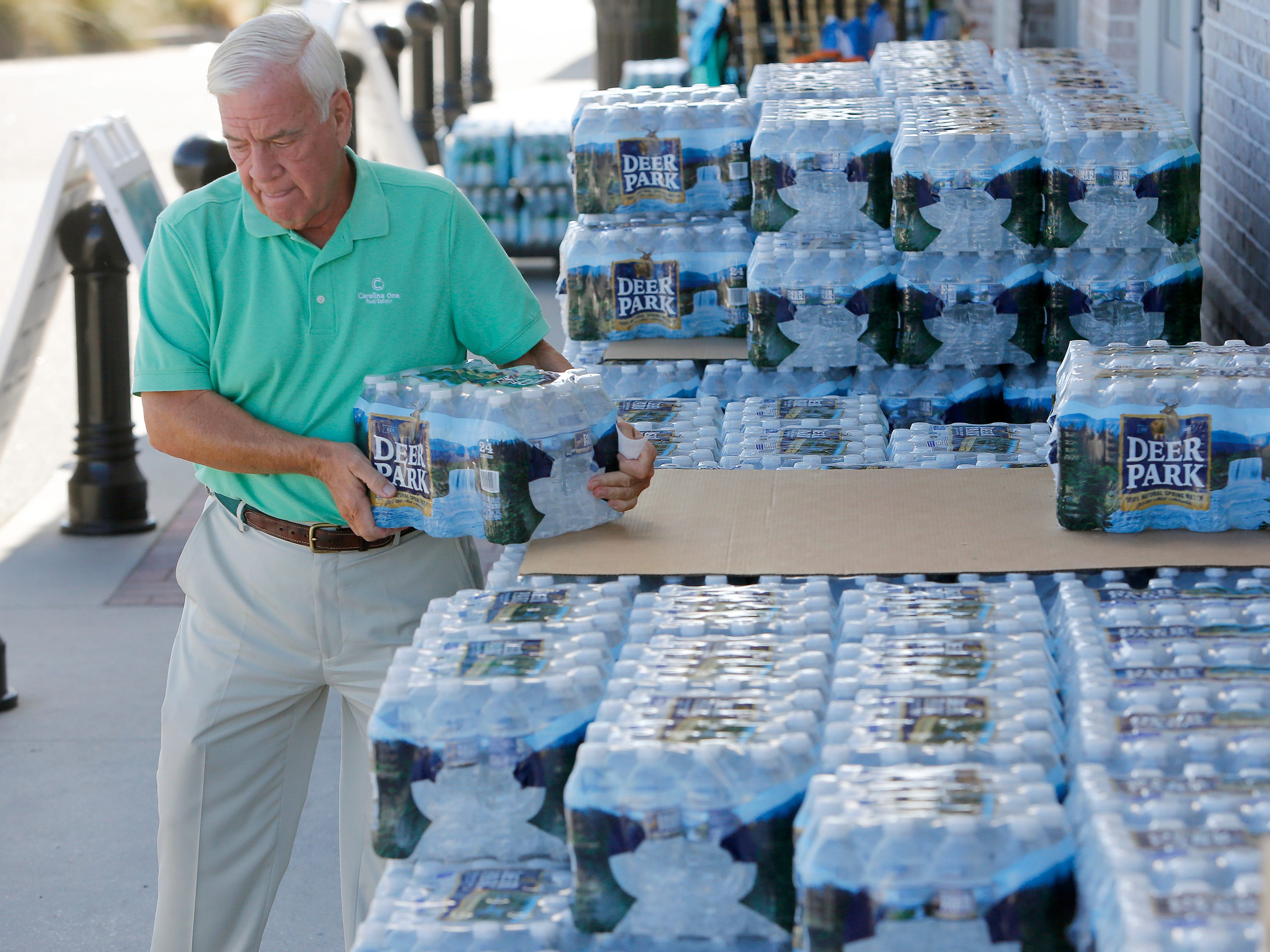 Larry Pierson, from the Isle of Palms, S.C., purchases bottled water from the Harris Teeter grocery store on the Isle of Palms in preparation for Hurricane Florence at the Isle of Palms S.C., Monday, Sept. 10, 2018.