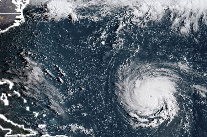A satellite image taken the morning of September 10, 2018, shows Hurricane Florence off the US East Coast in the Atantic Ocean.