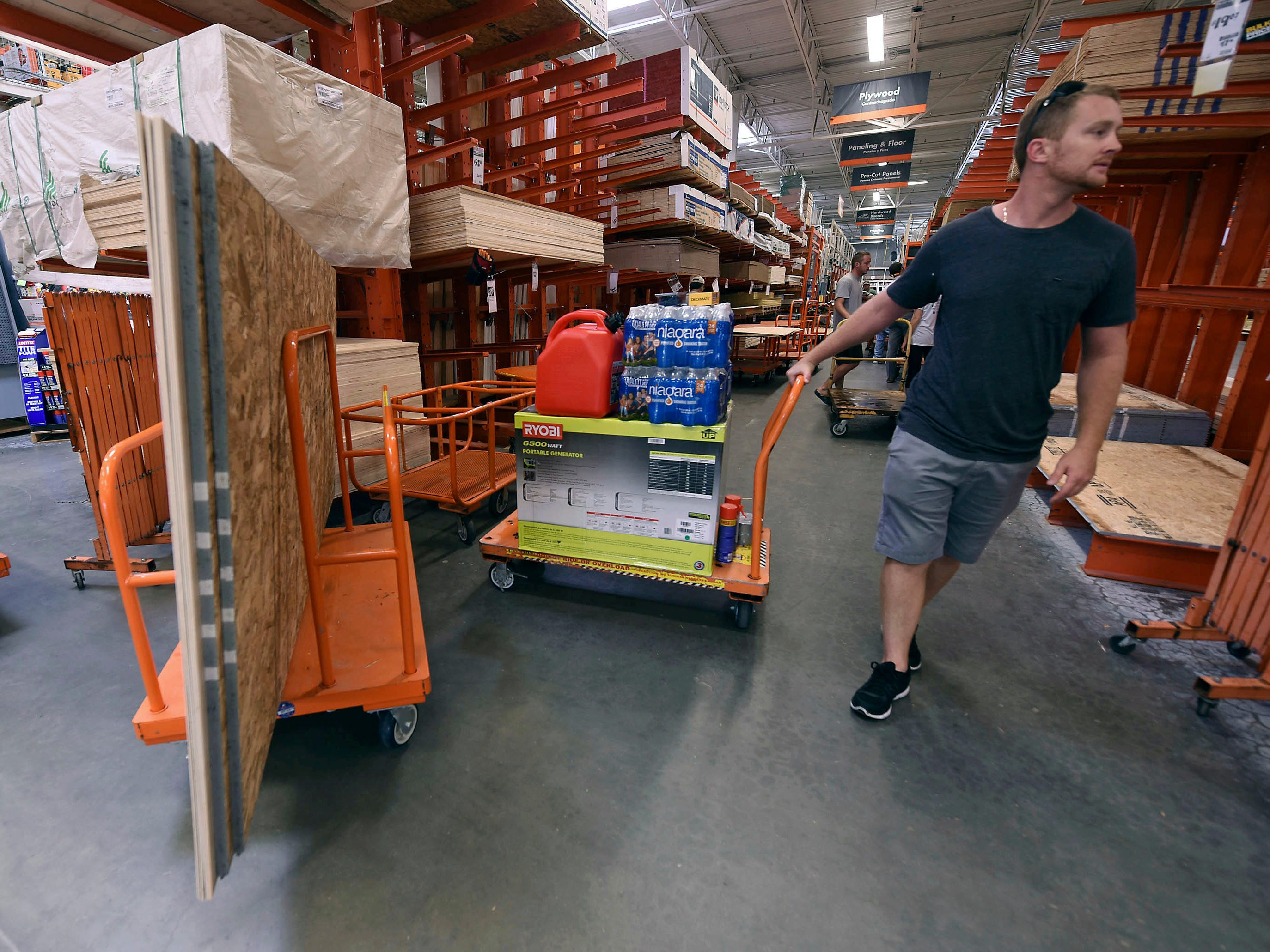 Alex Gilewicz buys supplies at The Home Depot on Monday, Sept. 10, 2018, in Wilmington, N.C. Residents of Wilmington and Southeastern N.C.