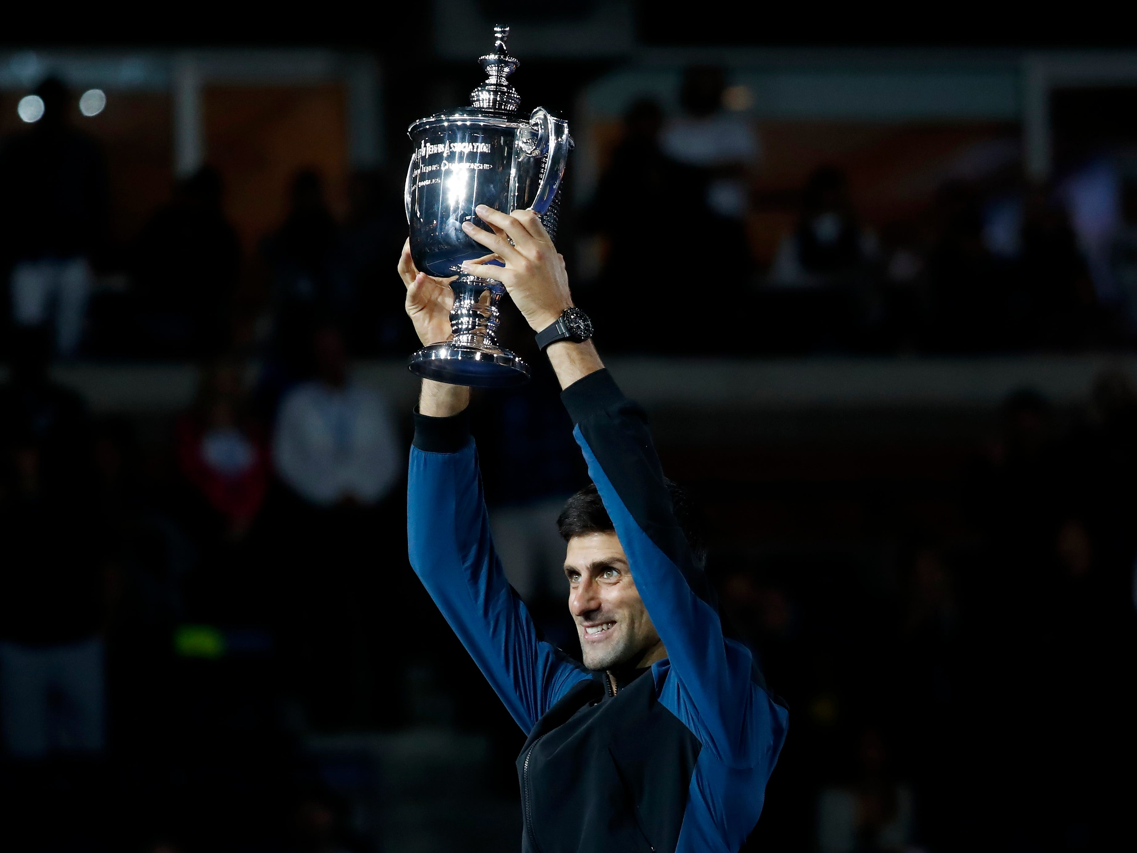 Novak Djokovic celebrates after winning his third career US Open title and 14th career Grand Slam championship.